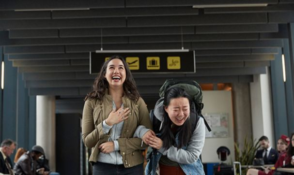 Girls laughing at the airport