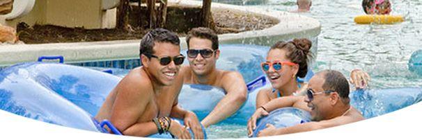 People floating in tubes in pool