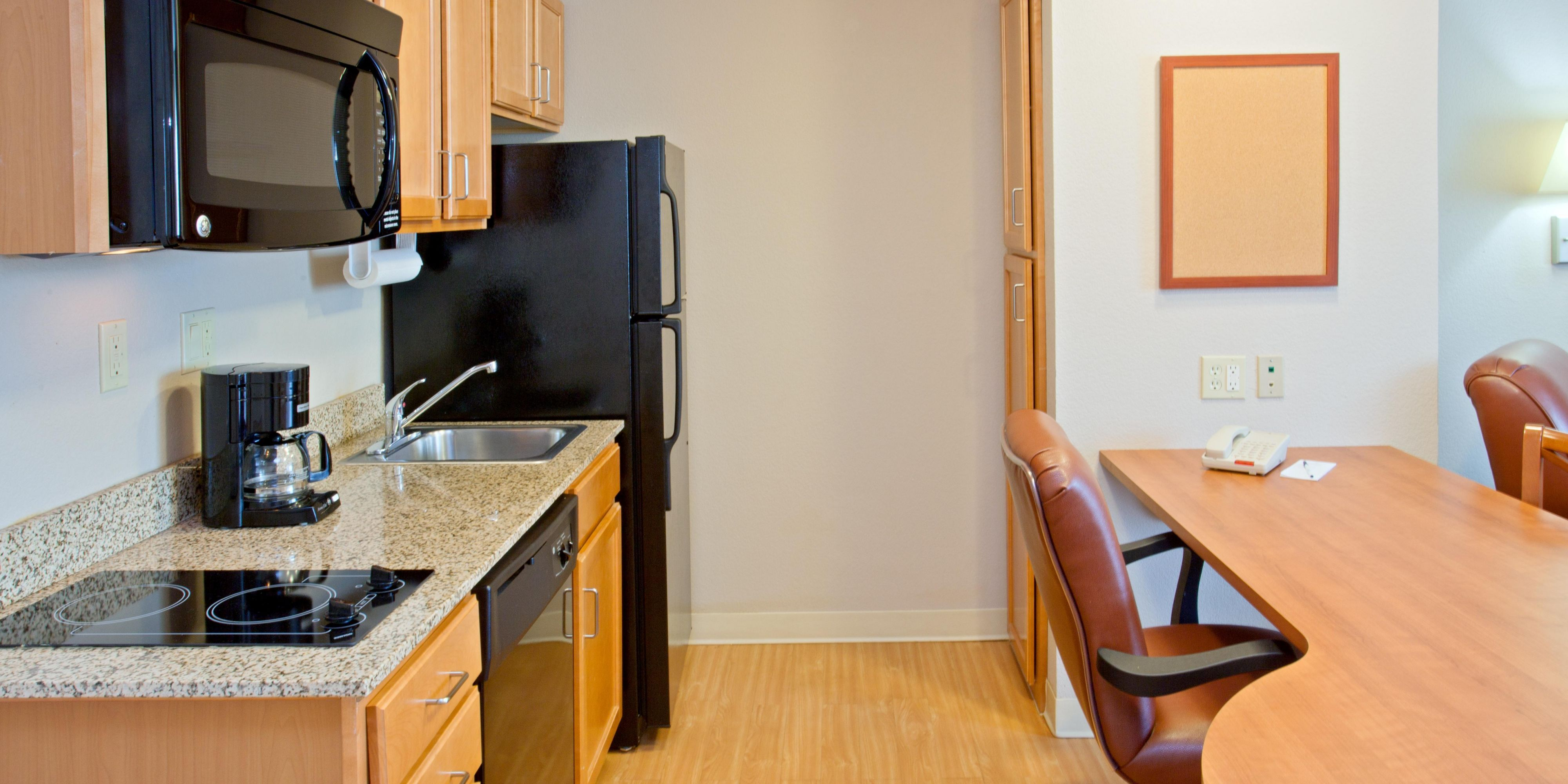 ... Hotel Exterior; Lobby Entrance; Full Kitchen In Every Suite ...