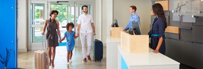 Family entering hotel lobby