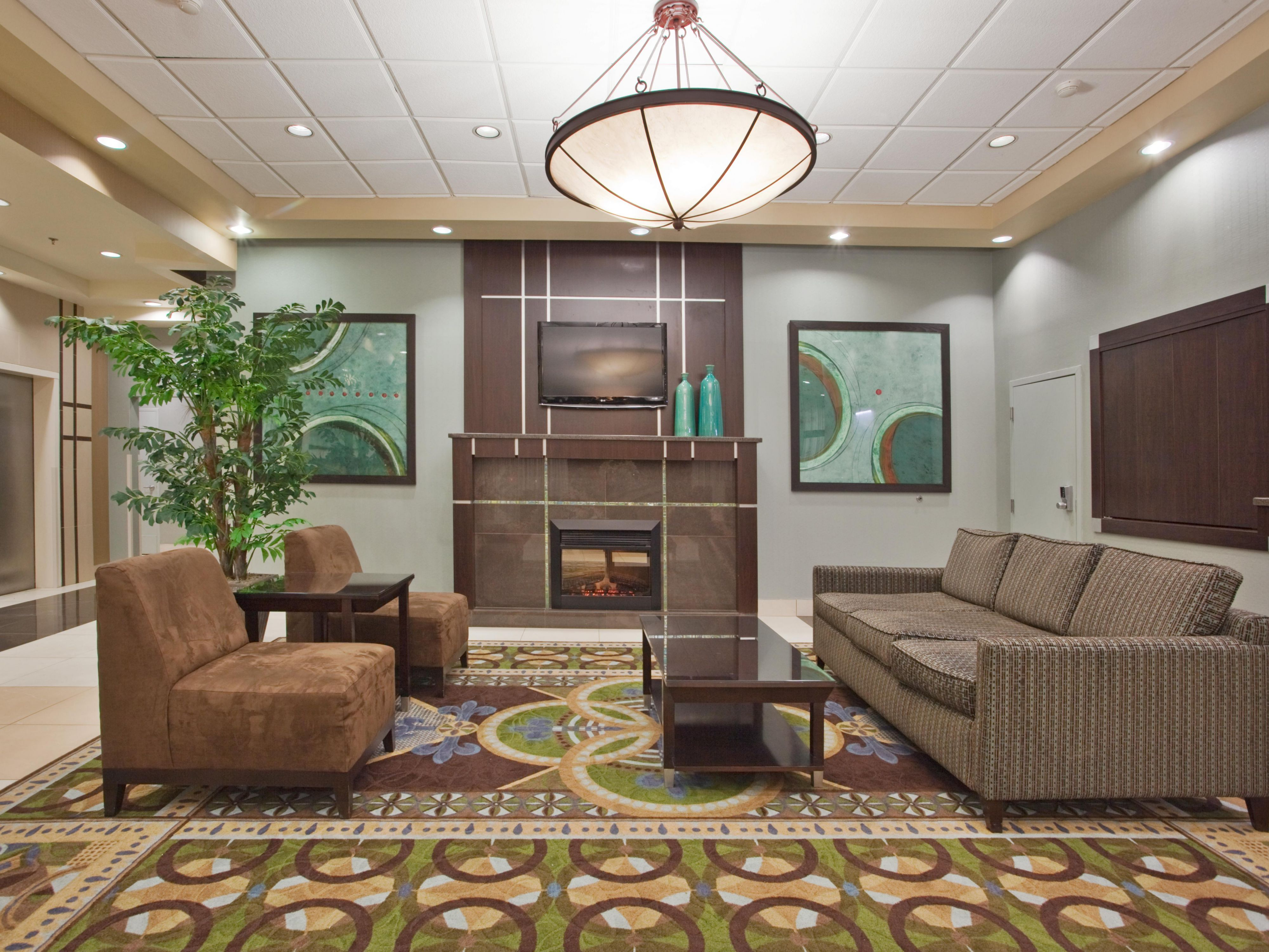 We have a Welcoming Fireplace at  Our Holiday Inn Binghamton Lobby