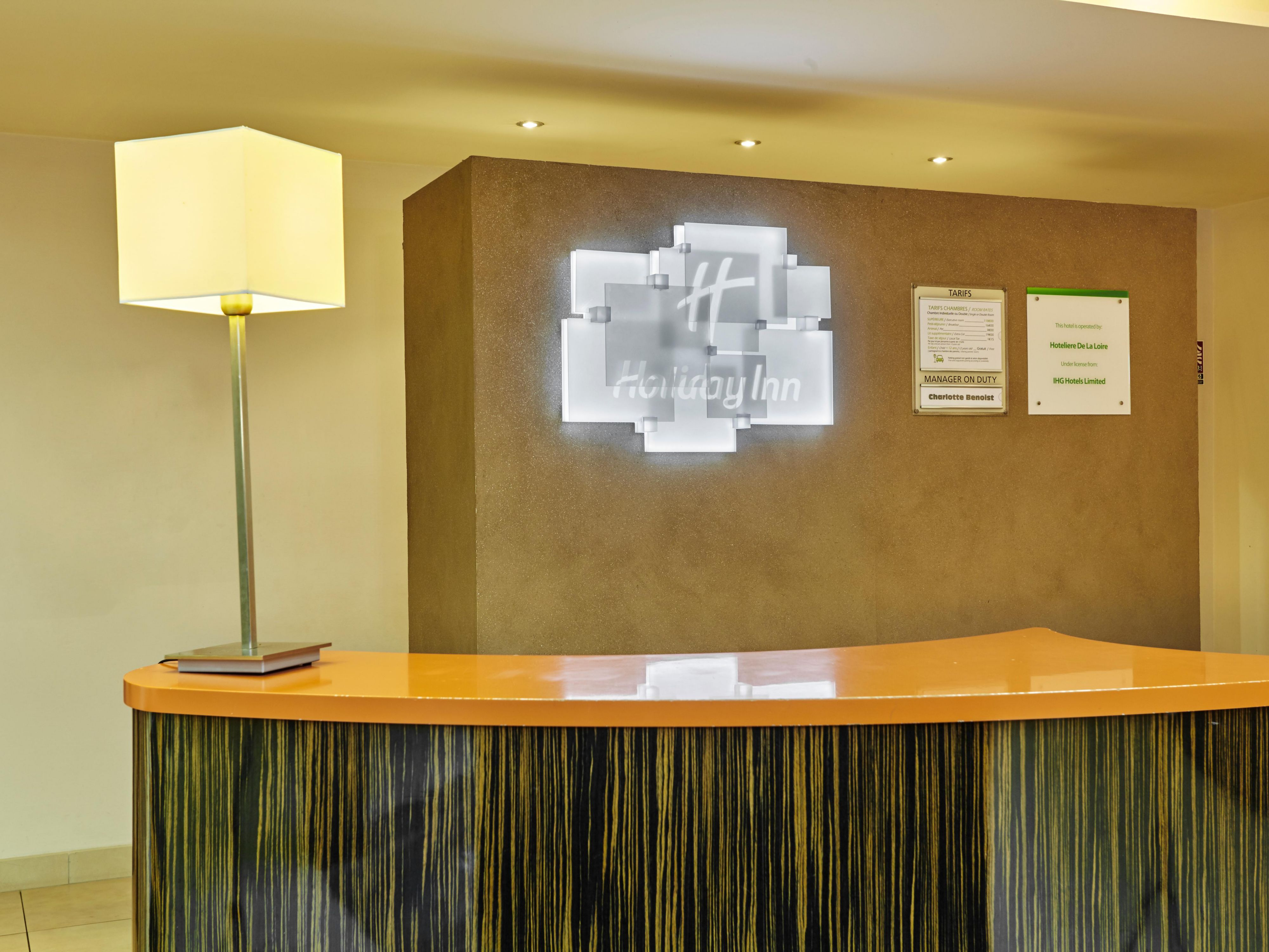 Check in at our contemporary Front Desk