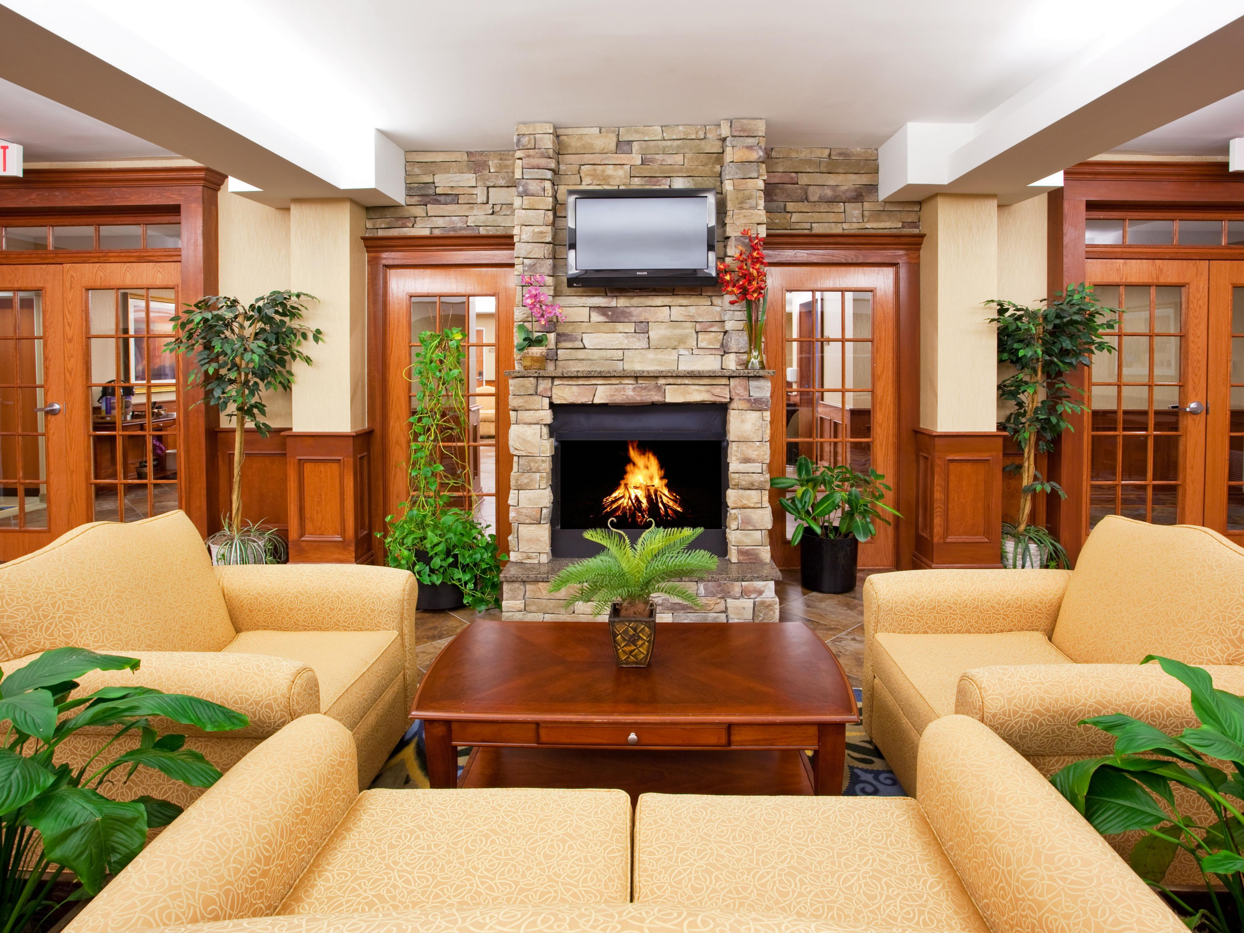 A cozy fireplace and seating area.