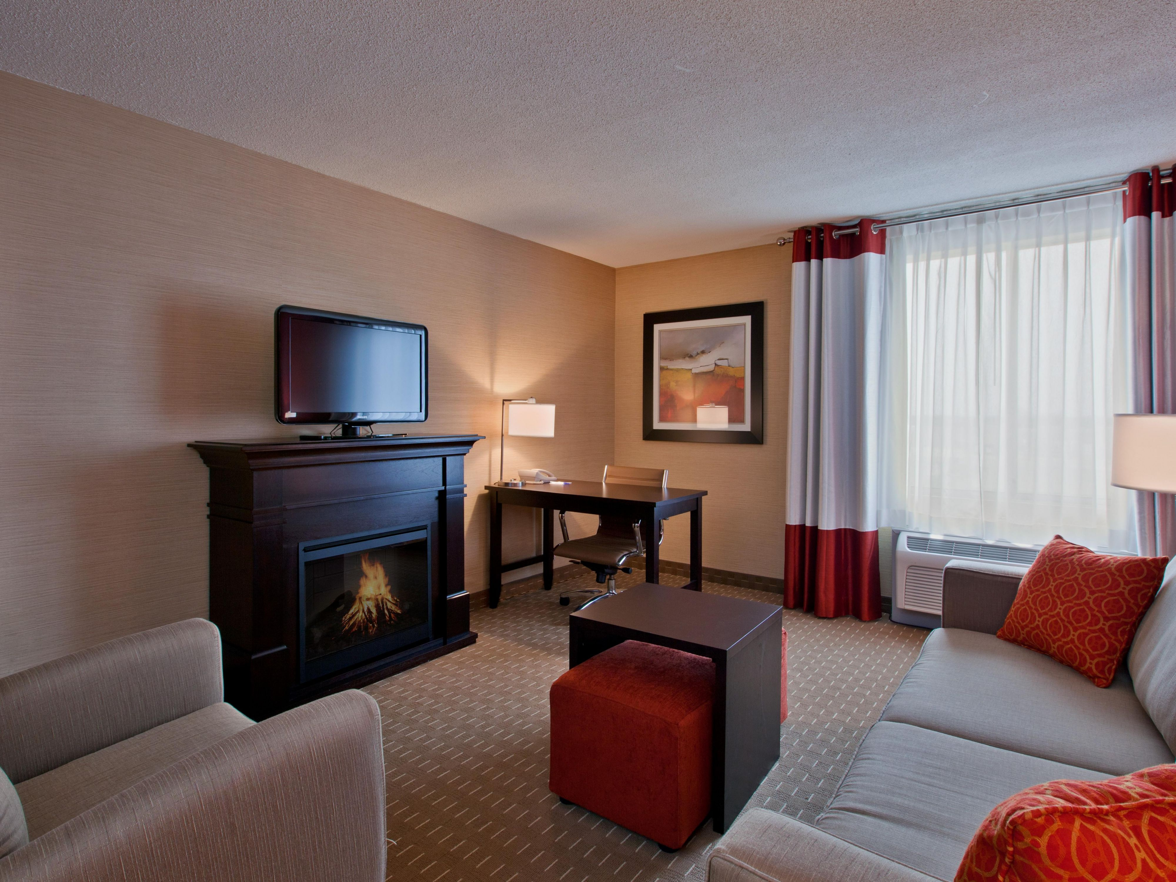 Enjoy the spacious living room portion of our 1 bedroom Suite