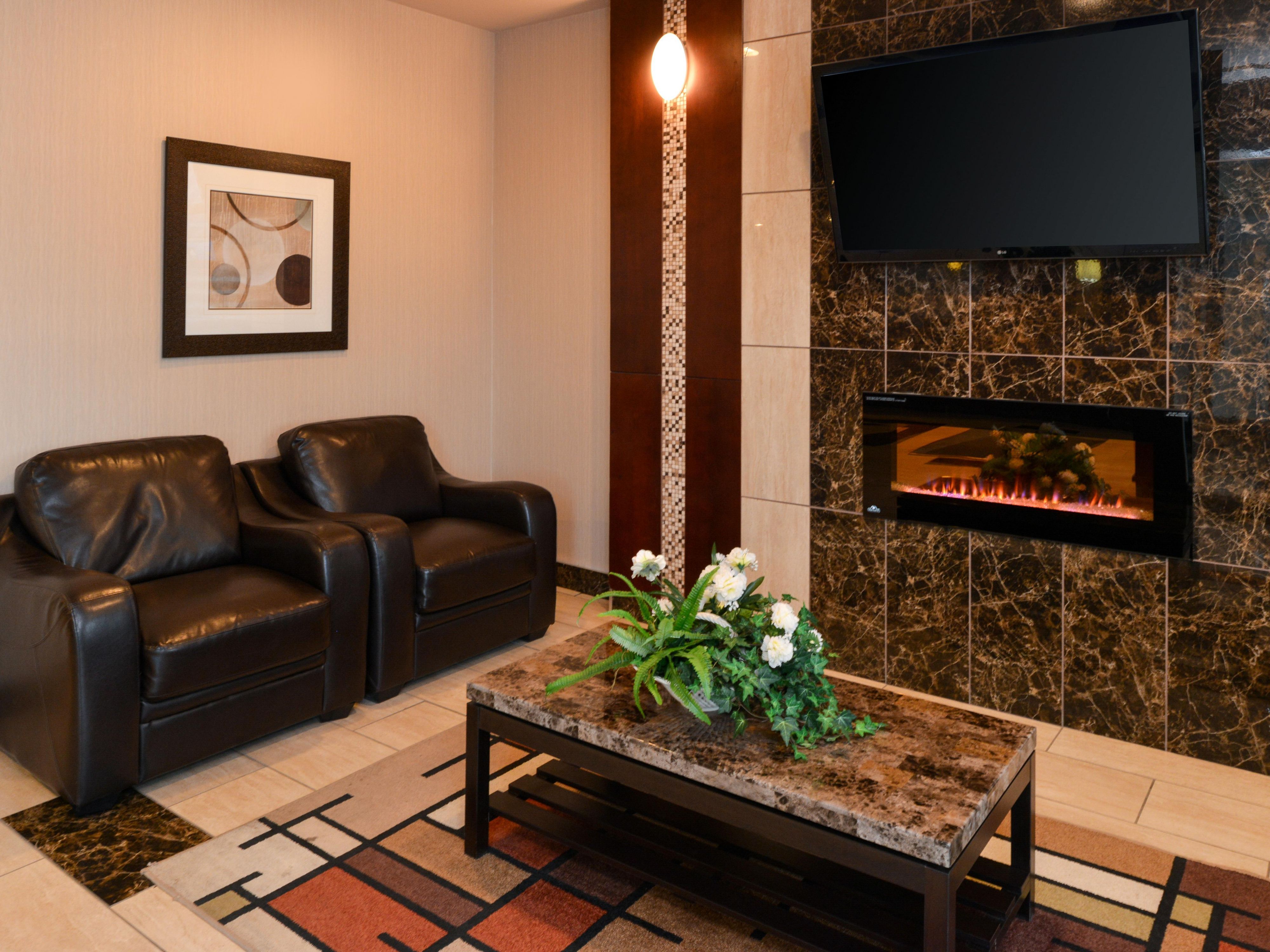 Watch television in front of a roaring fire in our Hotel Lobby.