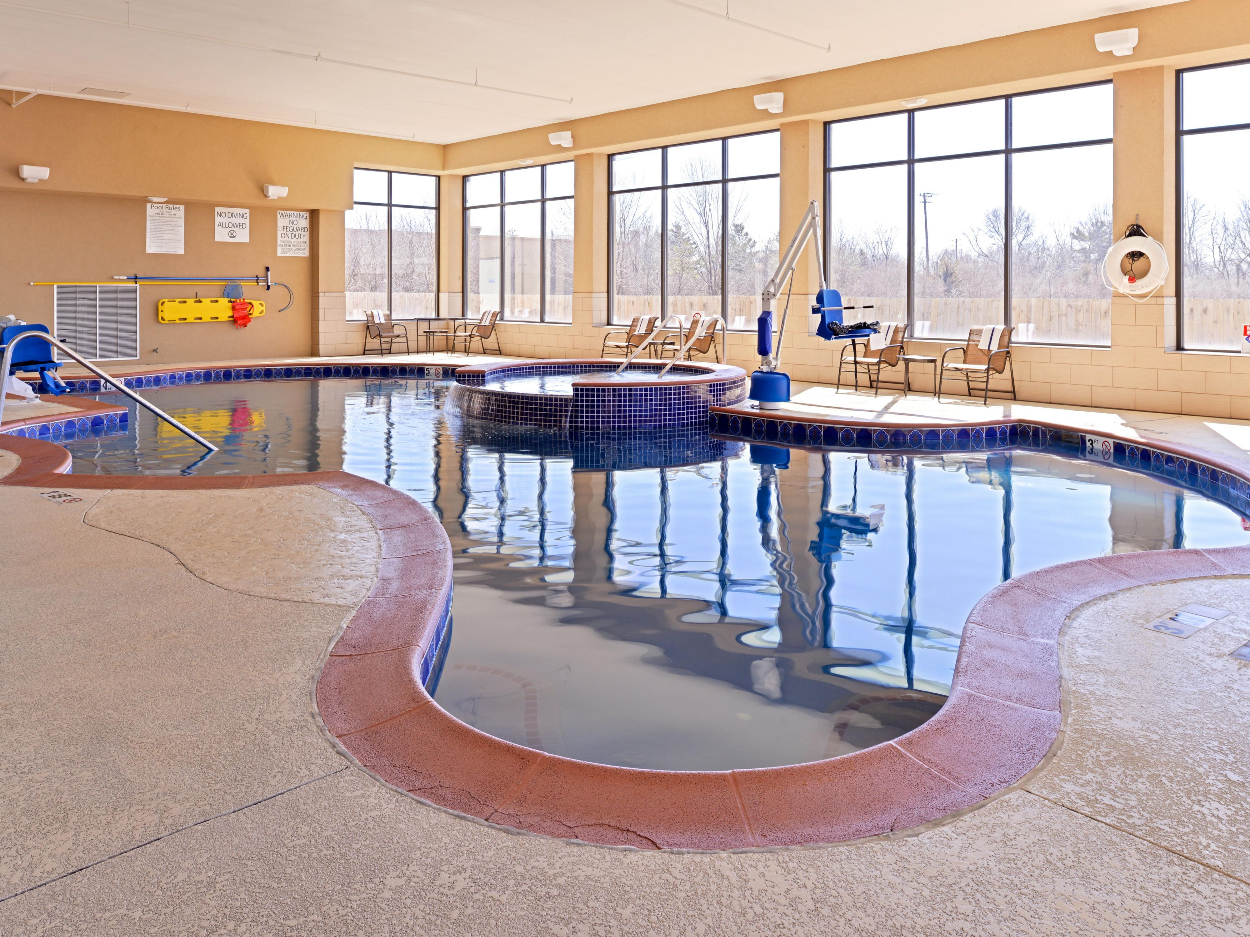 Indoor heated pool with raised infinity pool