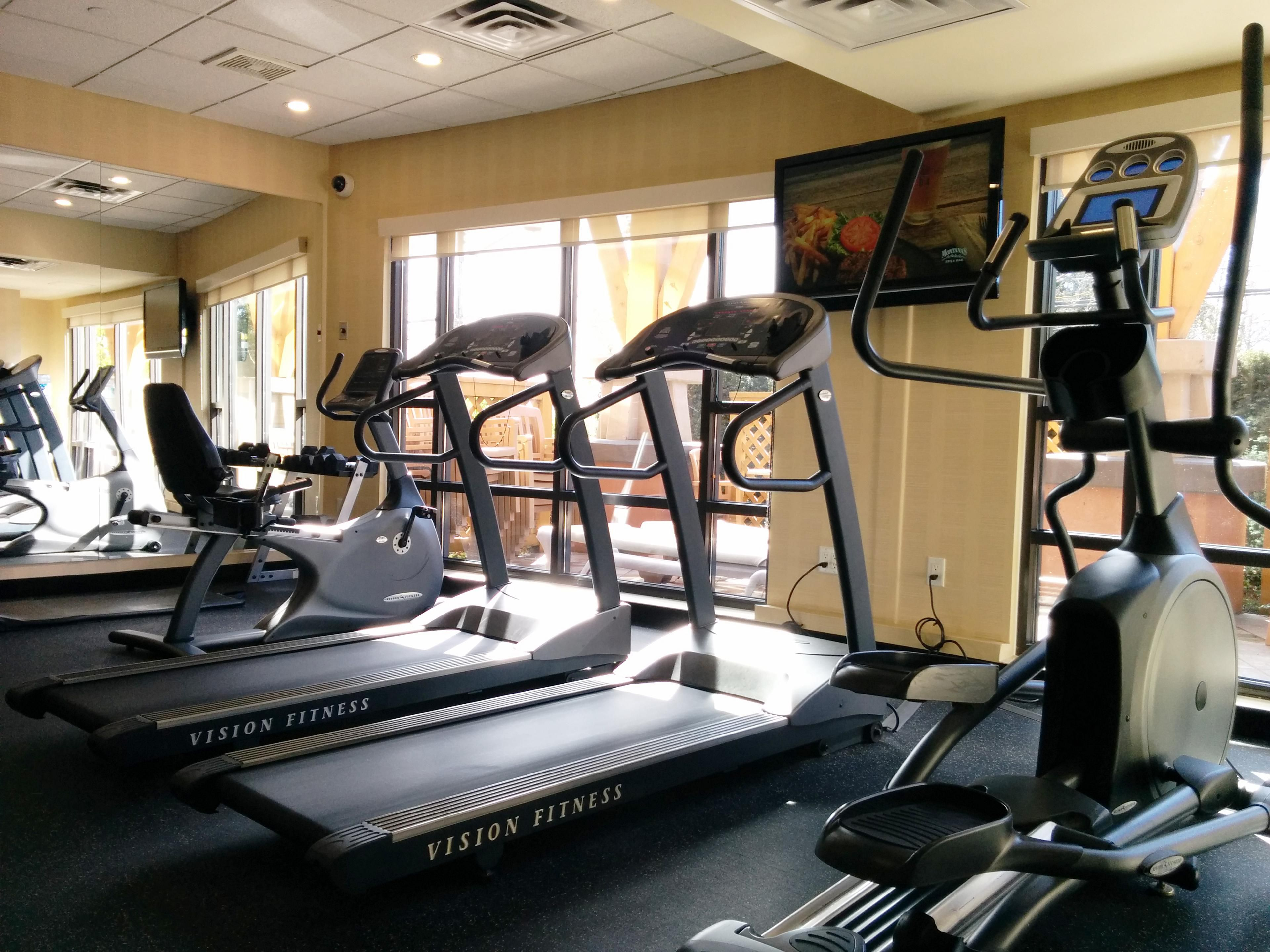 Fitness Center Complete With Treadmills, Ellipticals, & Weights.