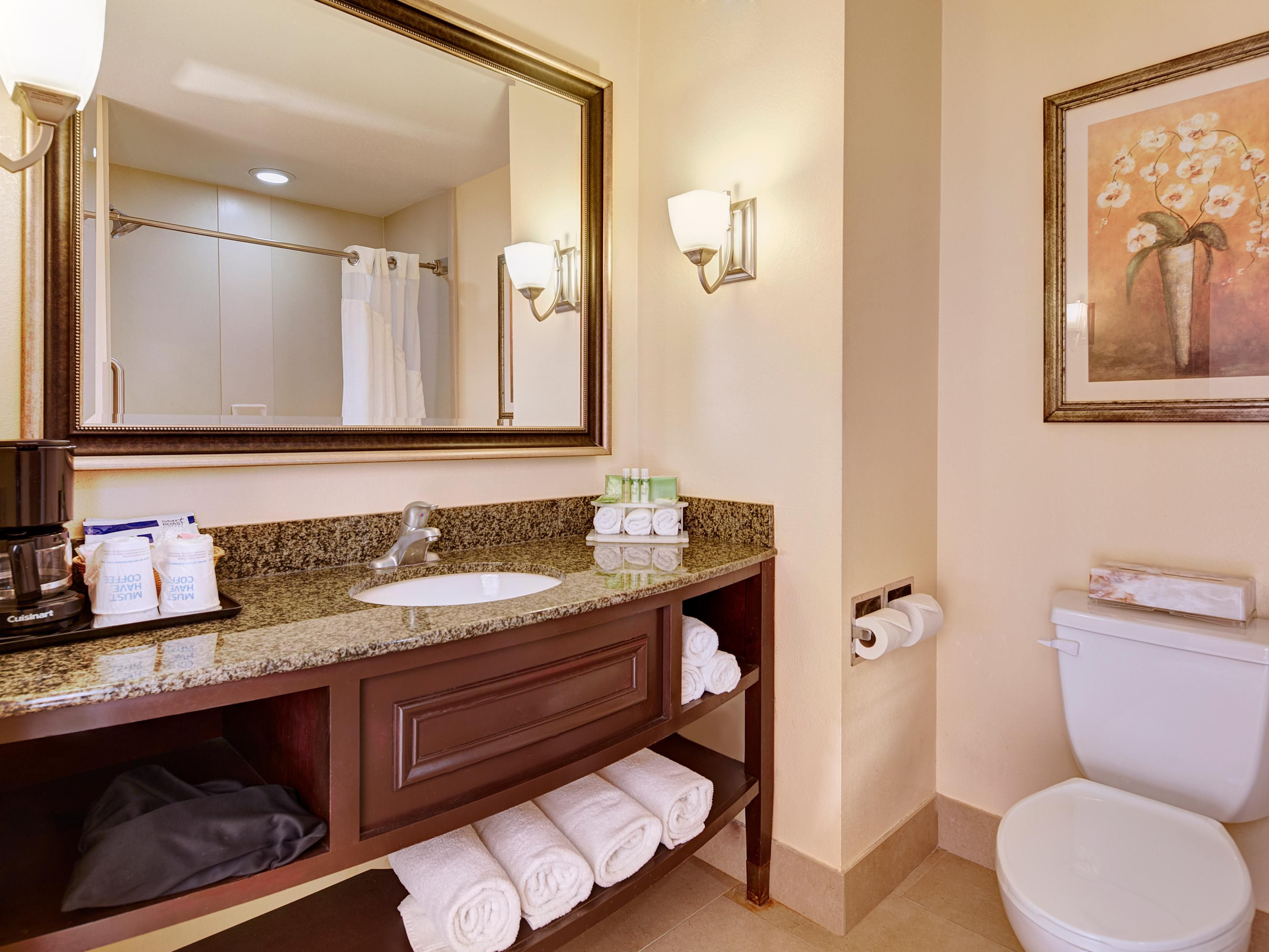 All of our bathrooms feature granite countertops.