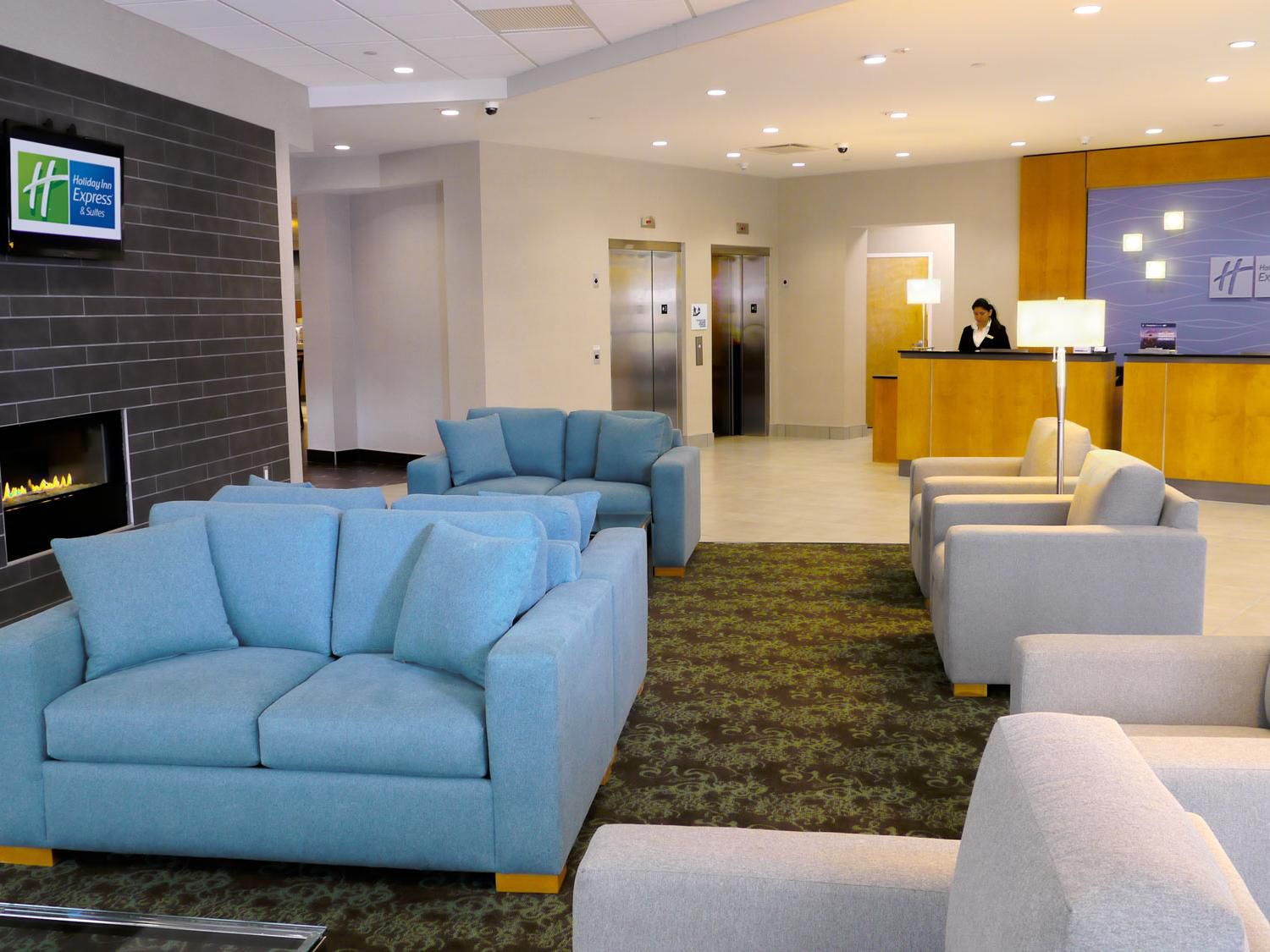 Come enjoy fireplace by our modern and spacious hotel lobby