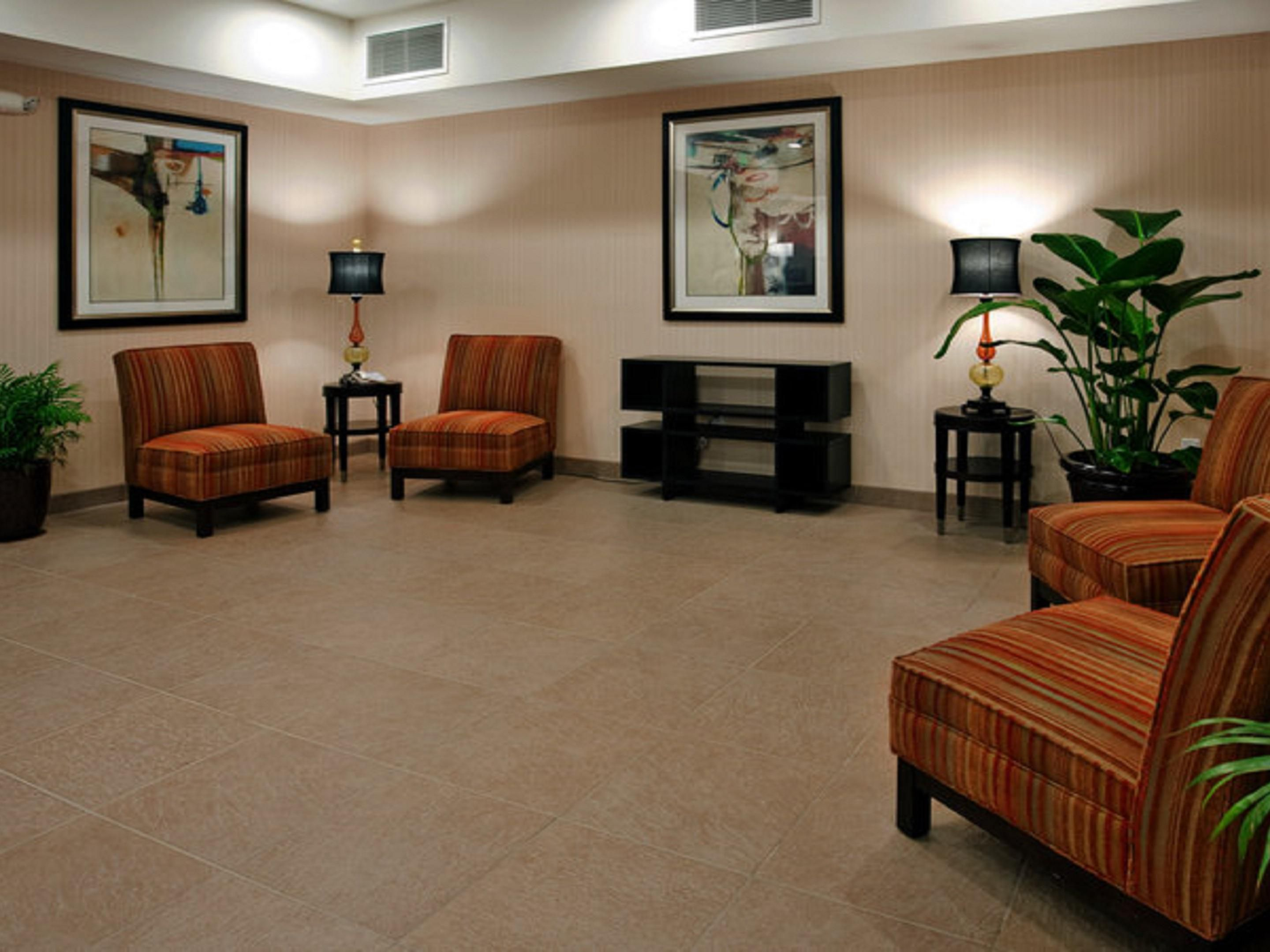 Relax in the hotel lobby at the Holiday Inn Express and Suites