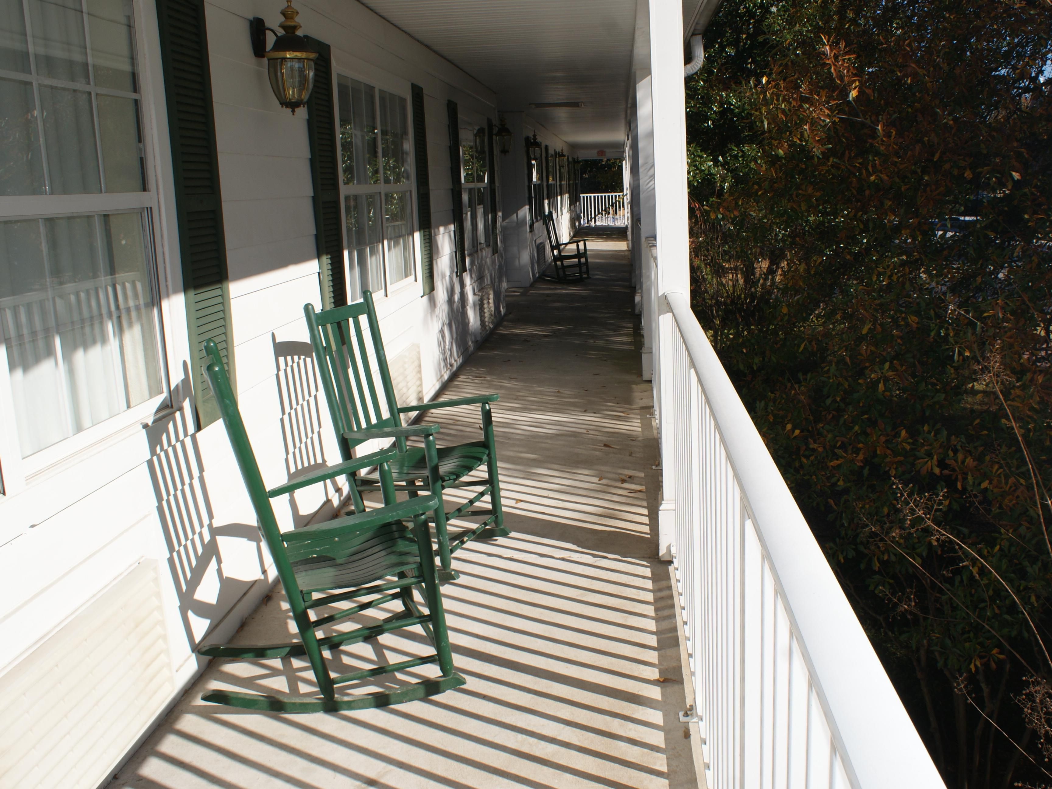 Wrap around porches with rocking chairs