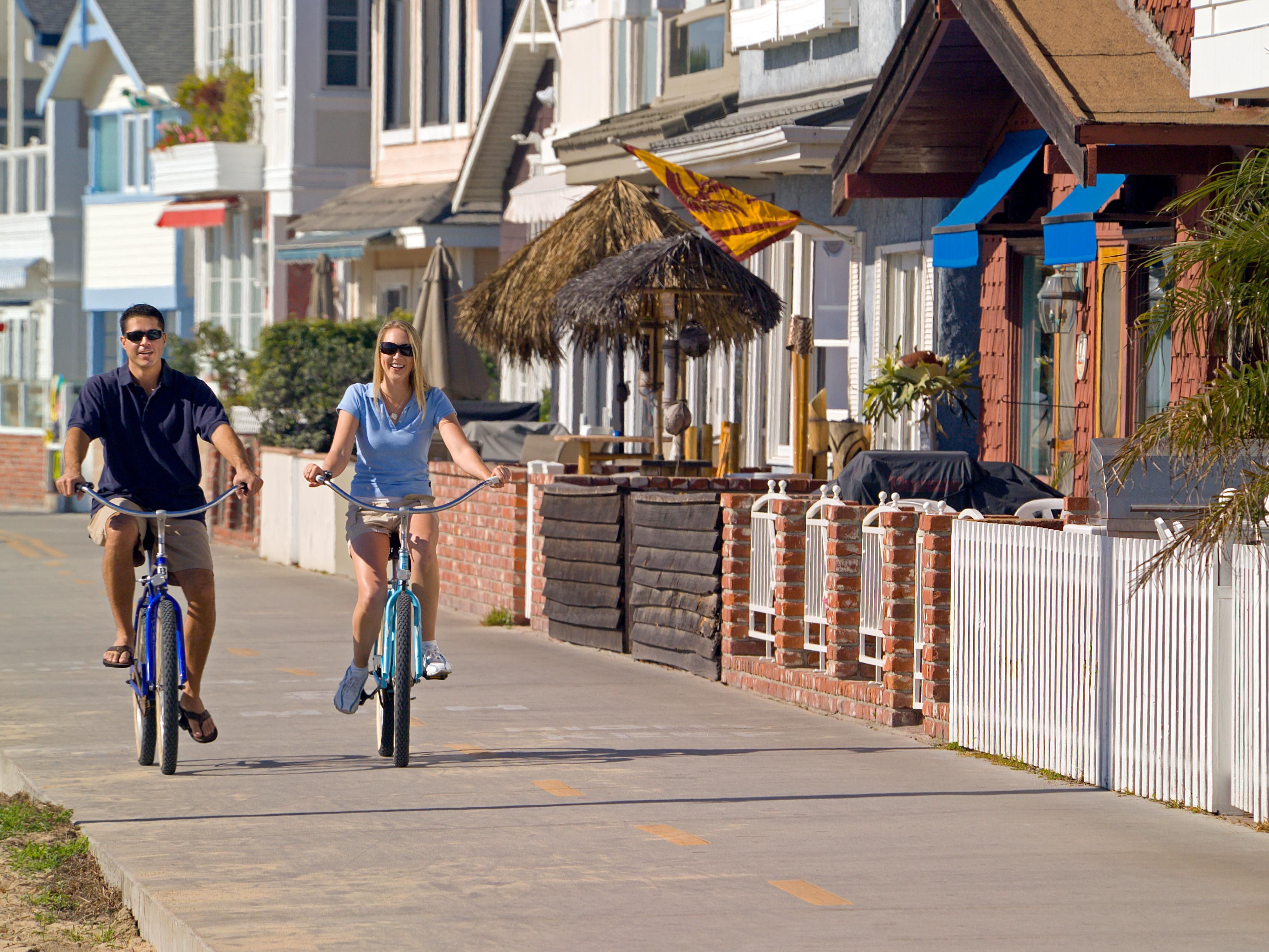 Biking along Balboa Peninsula Boardwalk