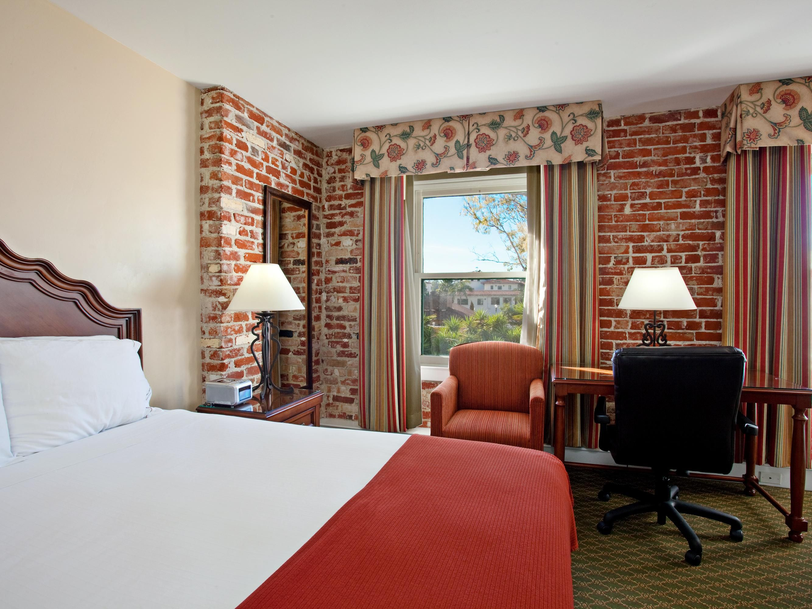 Queen Bed Guest Room with Original Brick Walls