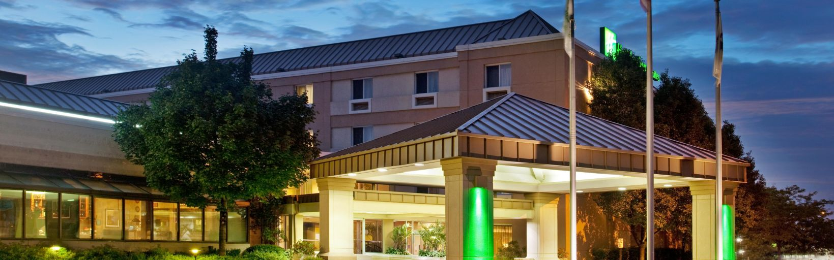 The Welcoming Glow Of Holiday Inn Suites Carol Stream Hotel Exterior