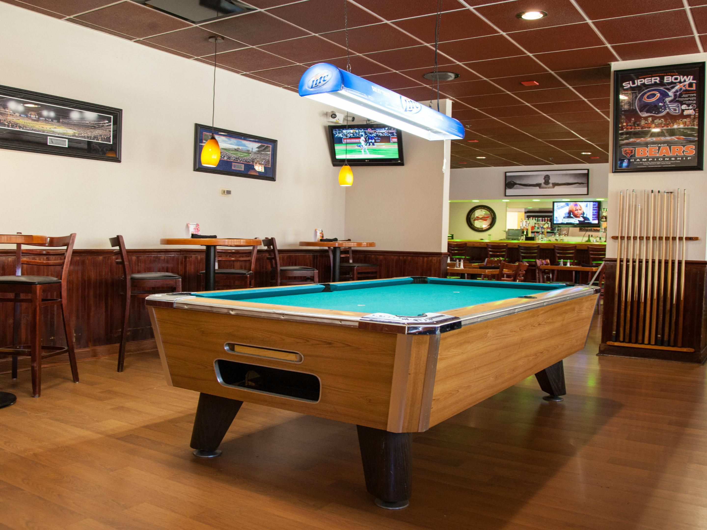 Relaxing game of pool at Sunny's Bar and Grill