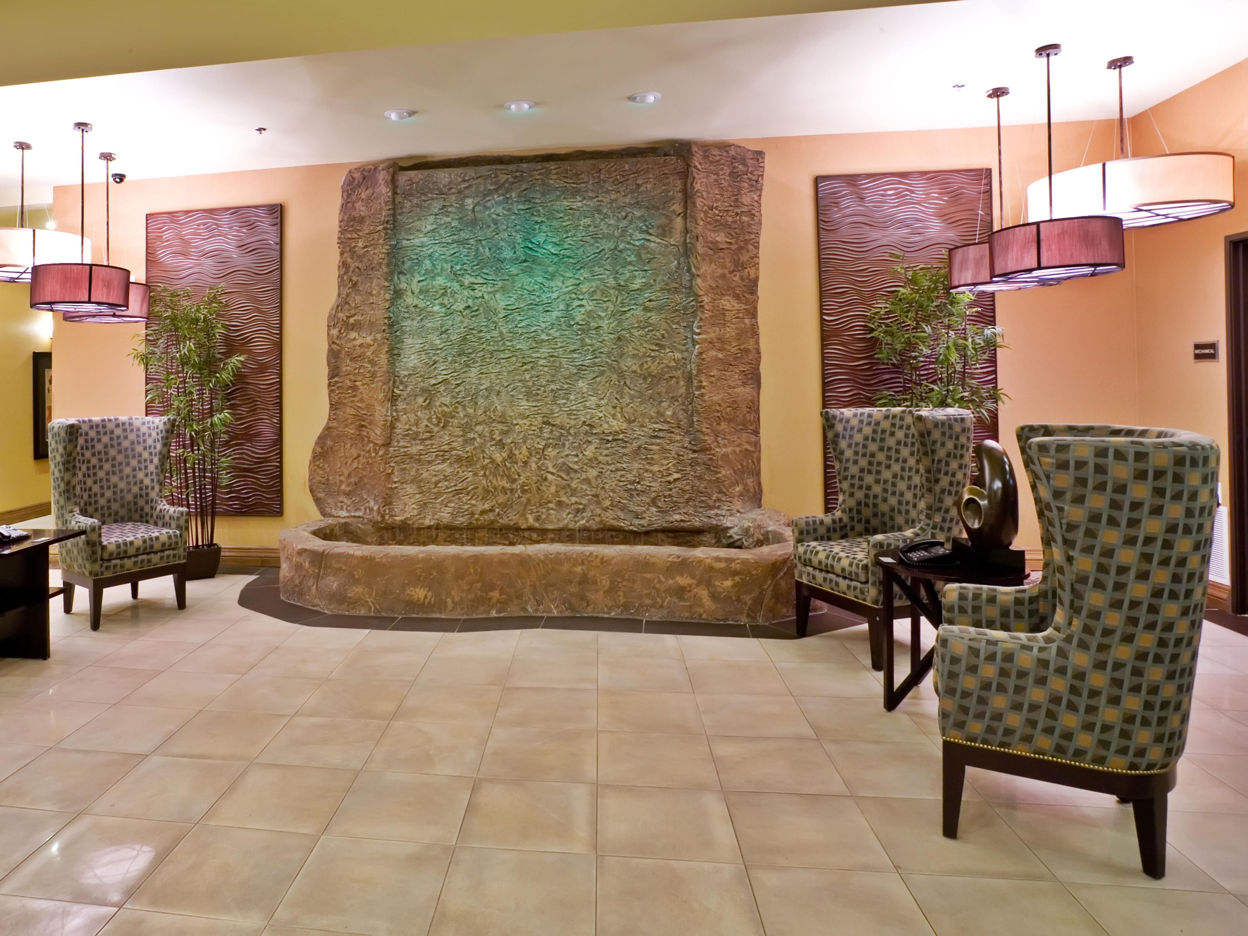 A rock water wall is the focal point of the lobby.