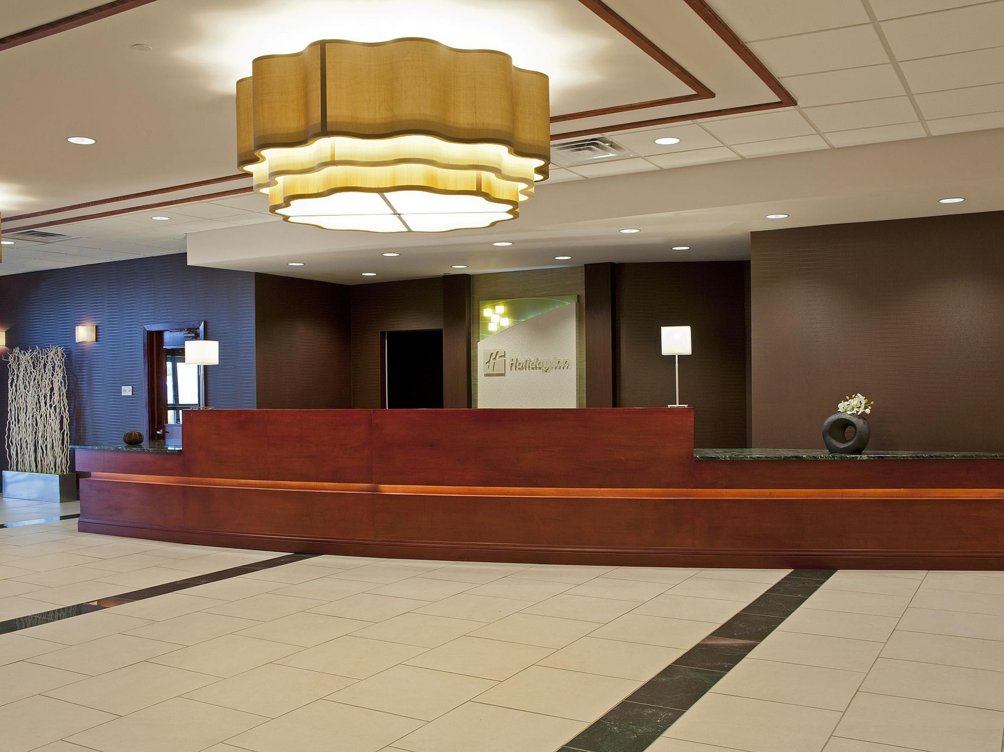 Warm Welcomes Await -  Front Desk at Holiday Inn Itasca near OHare