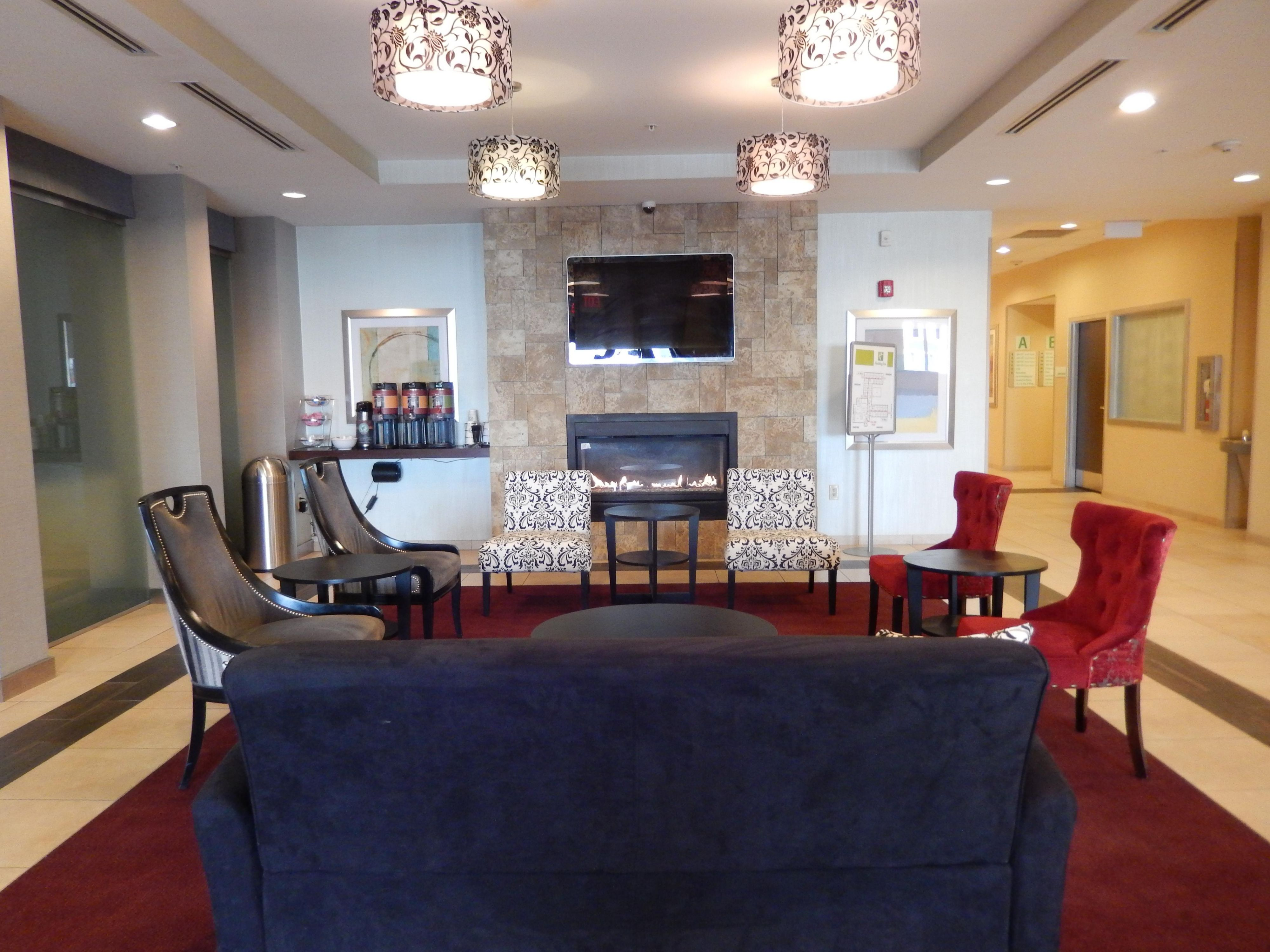 Sit by the fire and socialize with family in our lobby!