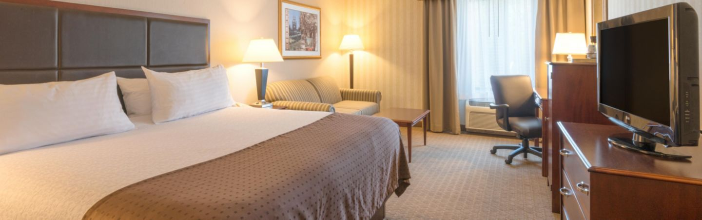 Newly Remodeled King Bed Guest Room with a queen size sofa bed IHG