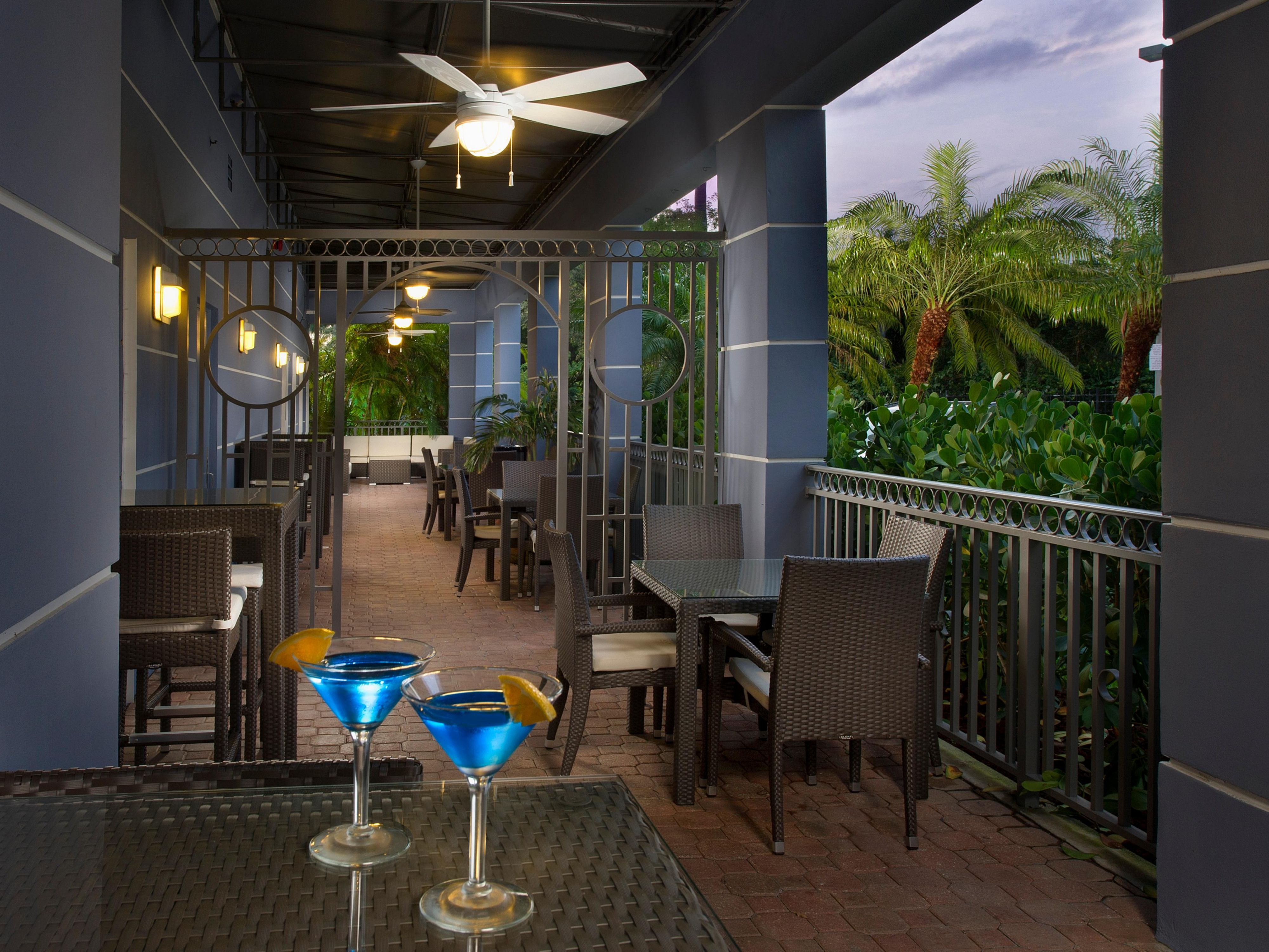 Seatback & enjoy a delicious drink by the patio