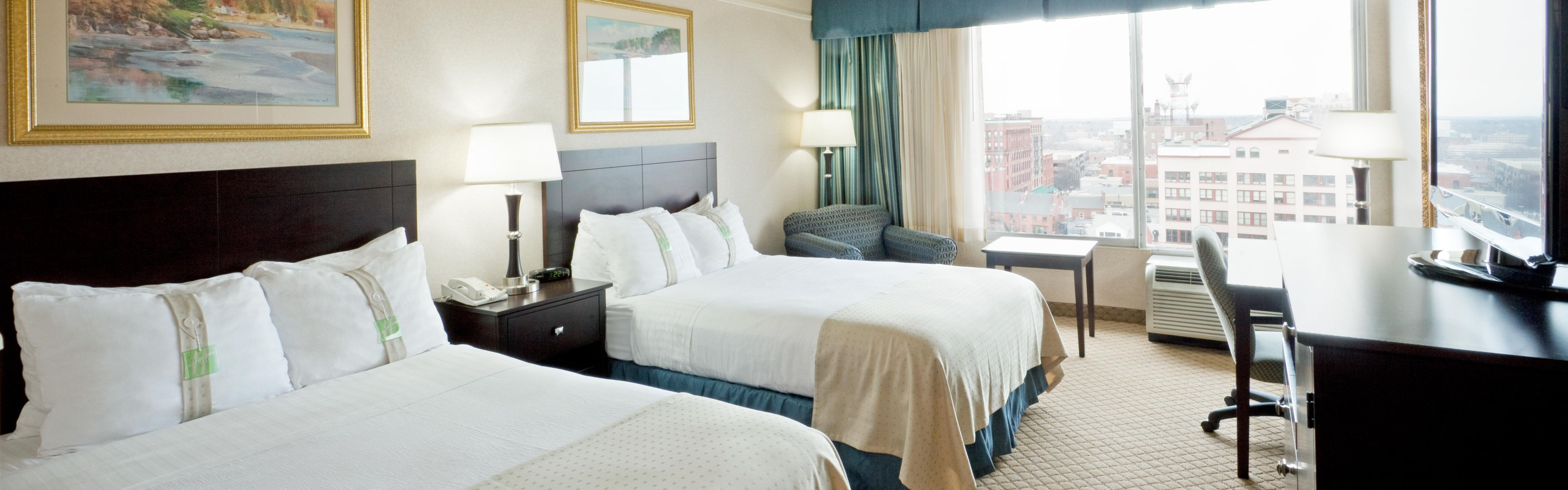 ... Two Double Beds With Views Of Casco Bay Or City Skylines.