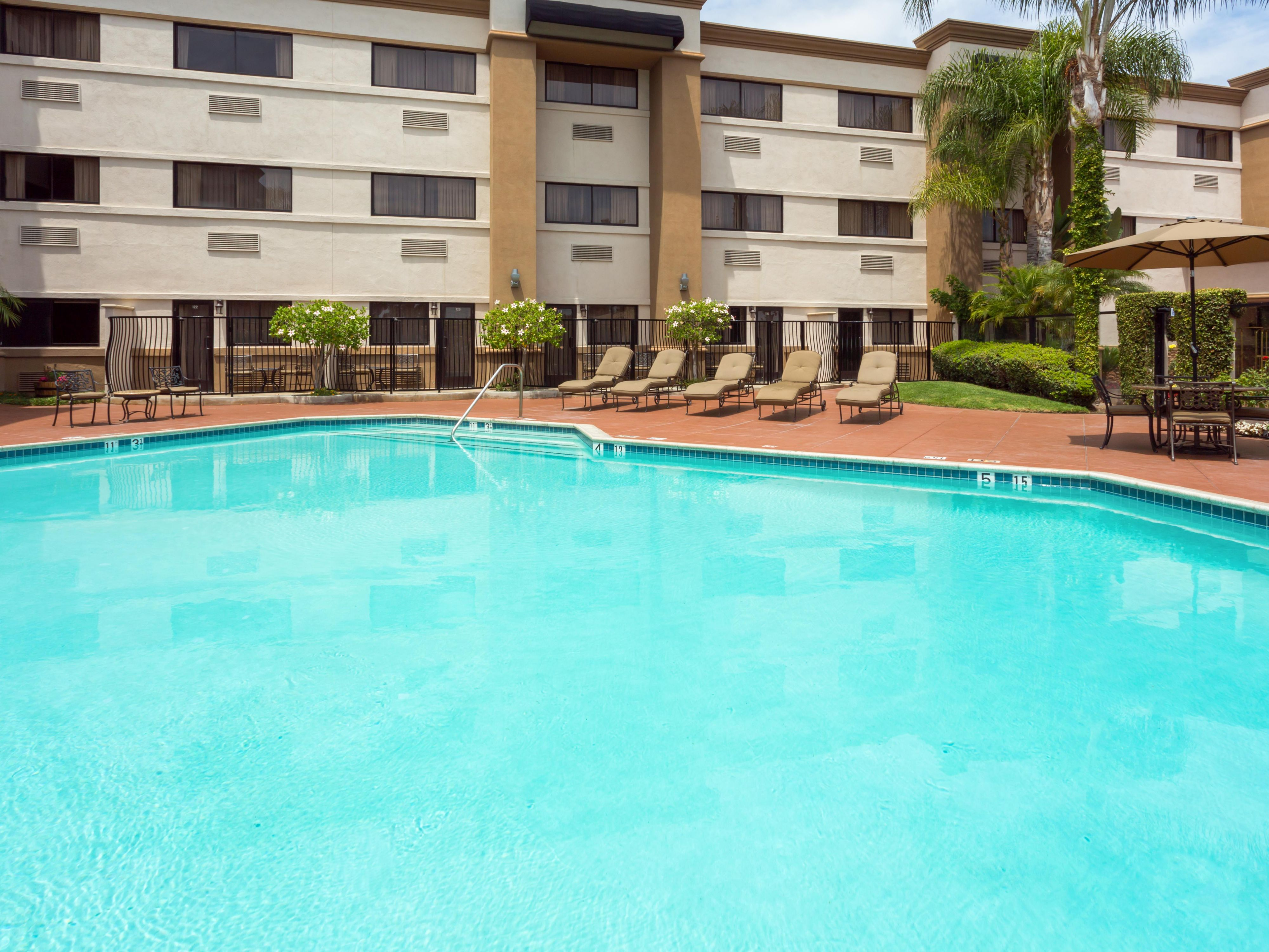 Soak up some California sun poolside at Holiday Inn OC Airport!