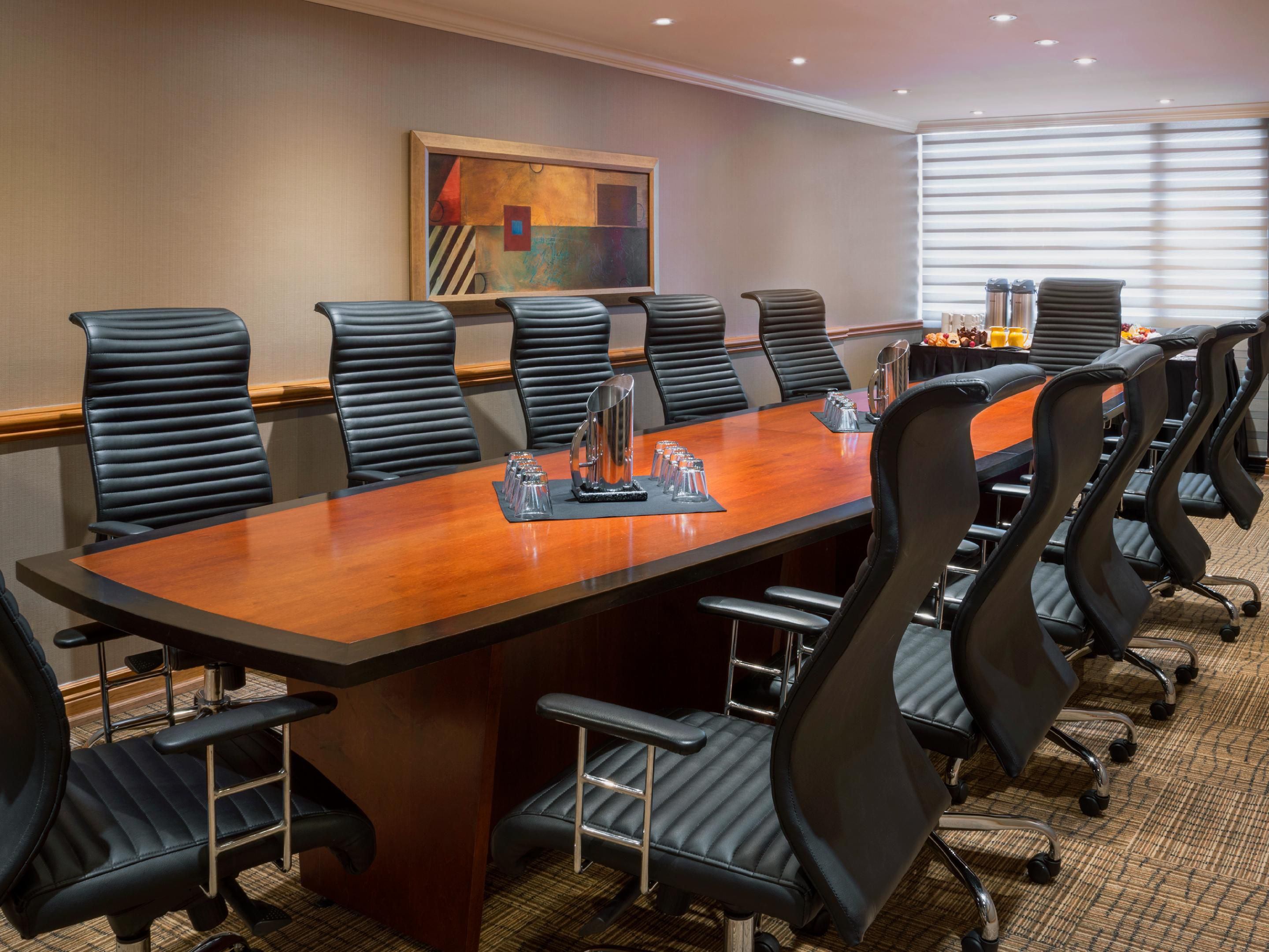 300 sq. ft. executive boardroom in Toronto with natural lighting