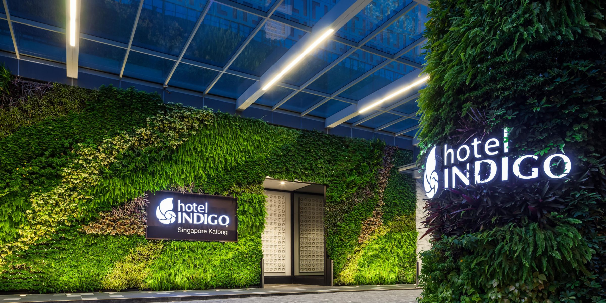 A Vertical Garden Welcomes Guests At The Entrance